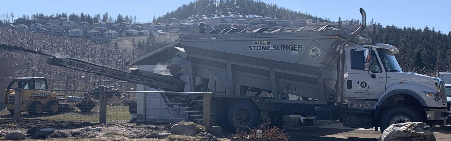 Kelowna Stoneslinger placing Topsoil in Garden