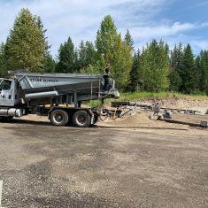Stone Slinger backfilling Foundation