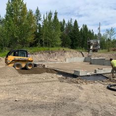 Bobcat Prepping foundation for concrete